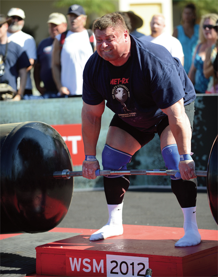 Zydrunas Savickas lay into the Giant Barbell, an extra-long IronMind S-Cubed bar with huge globes for a total weight of 790 lb.—and pulled an event-winning 8 reps at World's Strongest Man 2012. Randall Strossen photo.