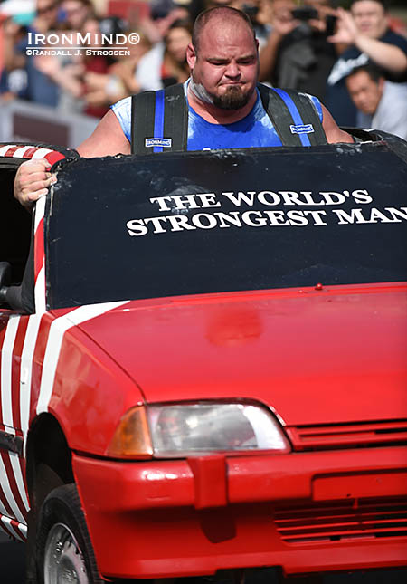 They might be popping out of the roof rather than stuck under the hood, but either way, that's a lot of cubic inches (in the form of Brian Shaw) in the Car Walk race at the 2014 World's Strongest Man contest.  IronMind® | Randall J. Strossen photo