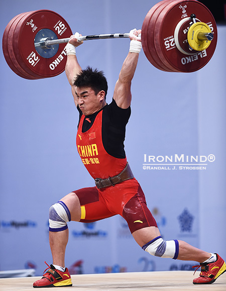 Liao Hui (China) came into this meet with the world record in the jerk and the total in the 69-kg class, and at the World Weightlifting Championships tonight, he added the snatch world record to his collection and pushed up his world record in the total, too, when he made this 193-kg clean and jerk on his second attempt. IronMind® | Randall J. Strossen photo
