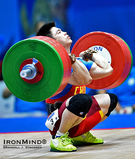 Lin Qingfeng hits rock bottom with 200 kg, attempting a world record in the clean and jerk at the Asian Games tonight. IronMind® | Randall J. Strossen photo
