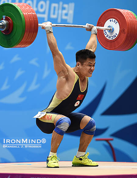 Gold medal lift: after missing the jerk twice with 200 kg, Lyu Xiaojun showed his grit by making a good lift with the weight on his third attempt. IronMind® | Randall J. Strossen photo