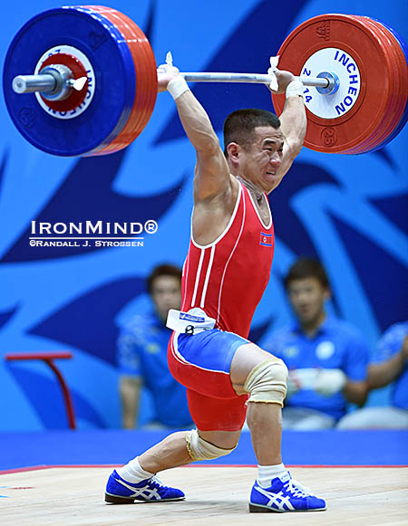 Finishing off the jerk, Om Yun Choi pounded this 170-kg lift, once again showing that triple-bodyweight clean and jerks are familiar territory for him. IronMind® | Randall J. Strossen photo