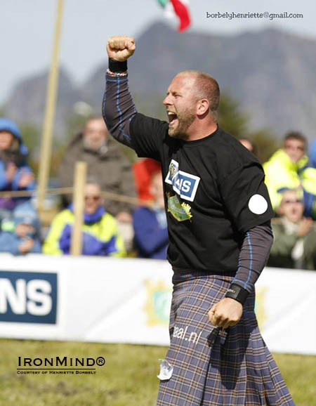 Pieter Karst Buoma celebrates his victory at the 2014 IHGF Amateur Highland Games World Championships.  IronMind® | Image courtesy of Henriette Borbely