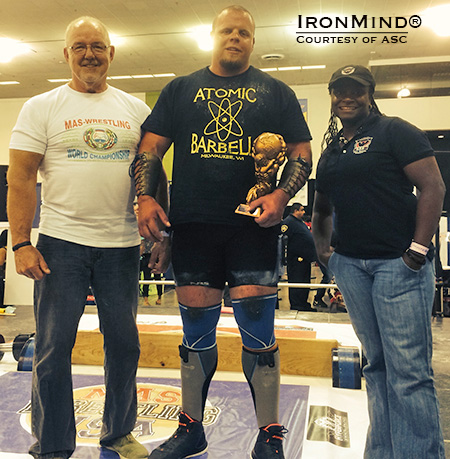 John Posen (center), flanked by Odd Haugen (left) and Dione Wessels (right), took top honors in the heavyweight class of the amateur strongman contest and thereby won his ASC pro card yesterday at the Odd Haugen Strength Classic, hosted by the FitExpo in San Jose, California.  IronMind®  Photo courtesy of ASC
