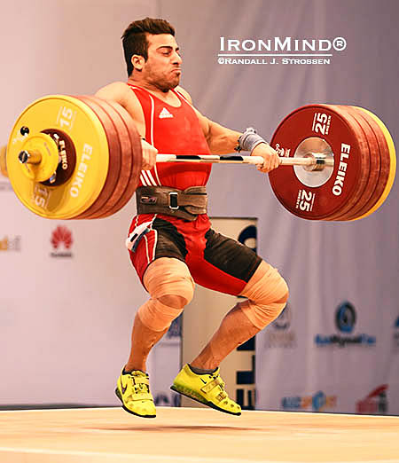 Kianoush Rostami (Iran) pulls himself under 213 kilos, in what proved to be the winning lift for both the clean and jerk, and the total. IronMind® | Randall J. Strossen photo