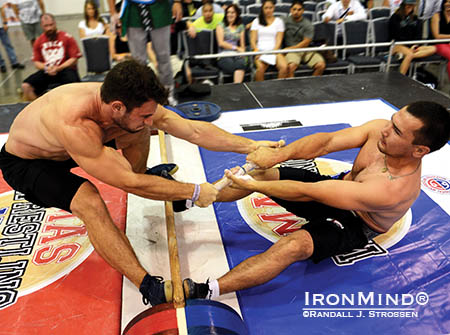 Sean Couch (left) gets launched by world champion Alexandr Arinkin at the North American Mas Wrestling Championships (held at the San Jose FitExpo earlier this summer). Couch will be a member of Team USA at the 2014 Mas Wrestling World Championships in Yakutsk, Russia in November. IronMind® | Randall J. Strossen photo