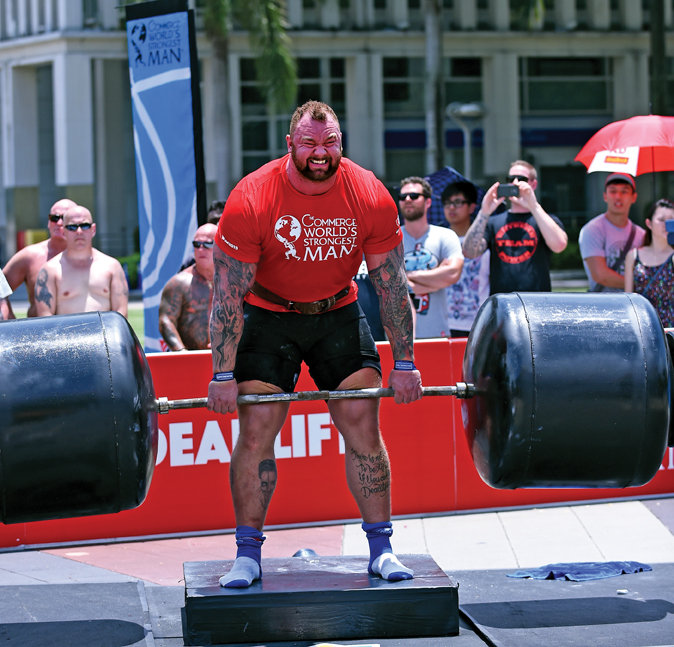 Hafthor Julius Bjornsson, using Strong-Enough Lifting Straps, grinds out reps on the deadlift at the 2015 World's Strongest Man competition in Putrajaya, Malaysia. Randall J. Strossen photo.