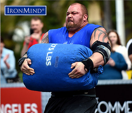 Hafthor Julius Bjornsson in flight with an IronMind Tough-As-Nails sandbag at World's Srongest Man 2014. Randall Strossen photo.