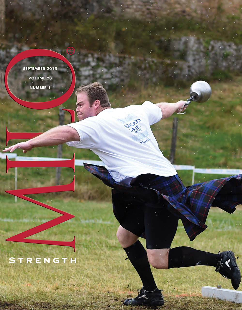 September 2015, Vol. 23, No. 2: Never mind the rain: classic Dan McKim, with a winning wind-up on the heavy weight for distance. McKim put himself in a deep hole by finishing in eighth place on the first event, the open stone, but by the end of the contest, he had fought his way back to the top, and then he laid all comers low on the weight for height, regaining the IHGF world champion's crown. Randall J. Strossen photo