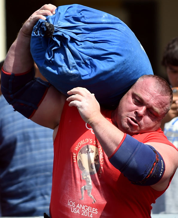 Dimitar Savatinov shoulders the Tough-As-Nails Sandbag at World's Strongest Man 2014. Randall Strossen photo.