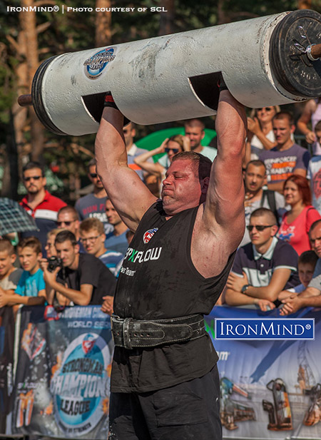 """Austrian strongman Martin Wildauer at SCL Serbia competing without sleeves in the log lift—an example of the raw power that SCL feels is true to strongman and strikingly different from what SCL co-founder Marcel Mostert calls """"neoprene-encased, gutless Teletubbies."""" IronMind® 