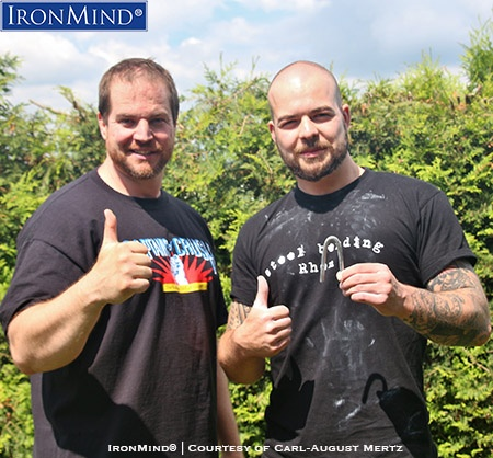 Jan Heller (right) has just been certified on the IronMind Red Nail and after his official bend, his referee, Carl-August Mertz (left), who is certified on both the Red Nail and the Captains of Crush No. 3 gripper, hosted a barbecue. IronMind® | Photo courtesy of Carl-August Mertz