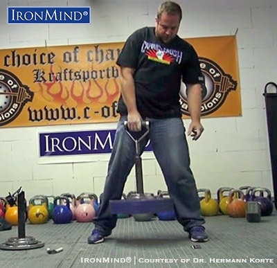 Carl-August Mertz on the Rolling Thunder portion of the Crushed-To-Dust! Challenge, a test of all-around grip -strength excellence that Carl-August Mertz passed with flying colors. IronMind® | Image courtesy of Dr. Hermann Korte/Choice of Champions gym