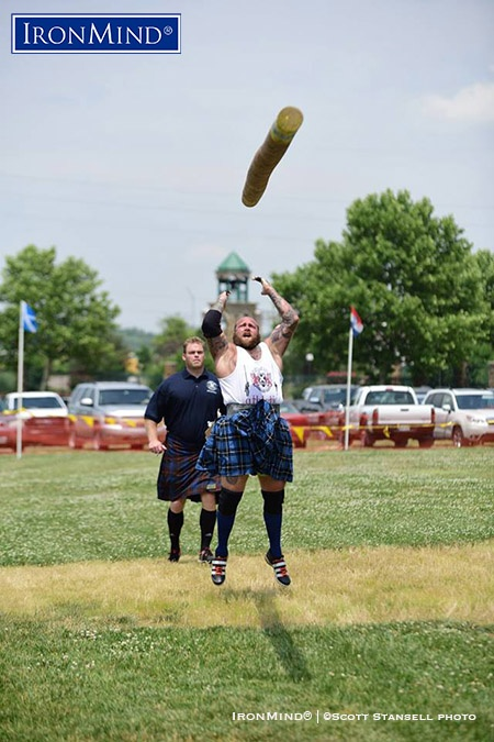 Dan Tennison, who won the IHGF All-American Caber Tossing Championship, turned three 12 o'clocks on the caber (under the watchful eye of professional Highland Games world champion Dan McKim, who served as a referee), as part of his winning performance at the 2016 Kansas City Highland Games.  IronMind® | ©Scott Stansell photo