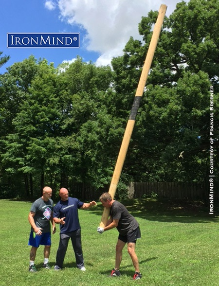 (left to right: Lonnie Captain Marvel, Francis Brebner, Jamie Munson) Before, it was a caber they couldn't turn, but after a little coaching from Francis Brebner, Captain Marvel and Jamie Munson tossed the stick. IronMind® | Photo courtesy of Francis Brebner
