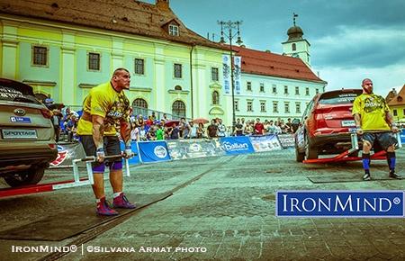 Mateusz Baron (Poland) squares off against Romanian Vladimir Comorovschi (Romania) in the deadlift at SCL Romania 2016. IronMind® | ©Silvana Armat photo