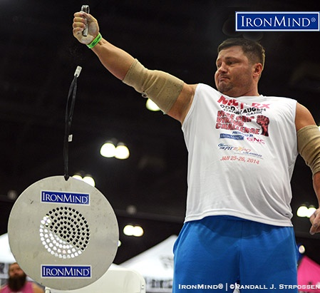 Alexey Tyukalov shown competing on the CoC (Captains of Crush) Silver Bullet Hold at the 2014 Los Angeles FitExpo. Tyukalov will be competing at the Chicago FitExpo next month at Odd Haugen's grip contest. IronMind® | ©Randall J. Strossen photo