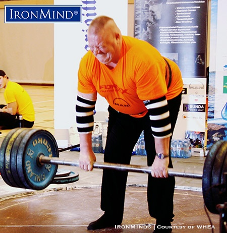 Finnish grip legend Arto Joronen lays it on the IronMind's Apollon's Axle, a benchmark grip strength event, in the 2017 Finnish Championships. IronMind® | Photo courtesy of WHEA.