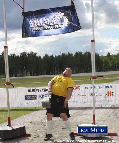 Henri Pakisjärvi in weight for height, on his way to winning the Finnish Highland Games Championships. IronMind® | Photo courtesy of WHEA