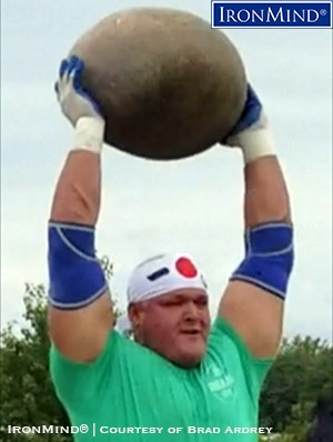 Brad Ardey banged out 9 reps on the overhead press with this 200-lb. manhood stone, en route to winning the final qualifier for the 2017 IHGF All-American Stones of Strength Championships. IronMind® | Photo courtesy of Brad Ardrey