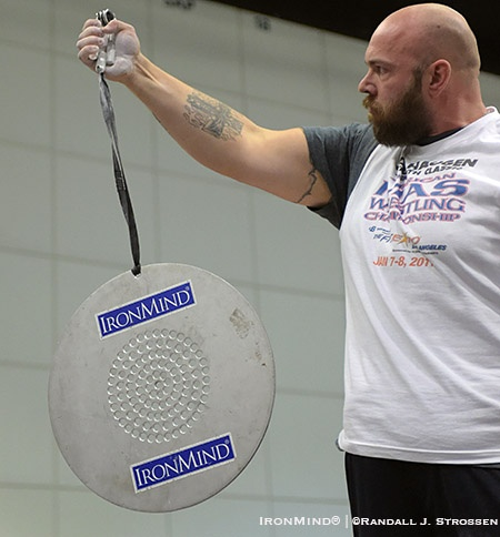 Establishing the world standard, Clay Edgin held the CoC Silver Bullet for 5.62 seconds using a Captains  of Crush No. 4 gripper in an exhibition at Odd Haugen's grip contest at the Los Angeles FitExpo this past weekend. IronMind® | ©Randall J. Strossen photo