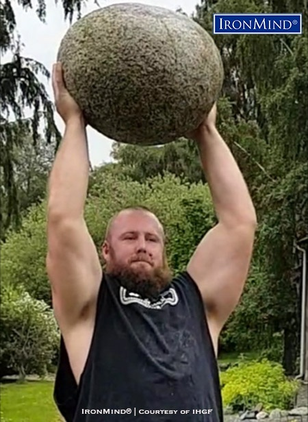 Luke Reynolds (Australia) puts the most famous of all manhood stones—Scotland's Inver stone—overhead. Reynolds will be competing in the IHGF Stones of Strength World Challenge in Fefor, Norway. IronMind® | Courtesy of IHGF