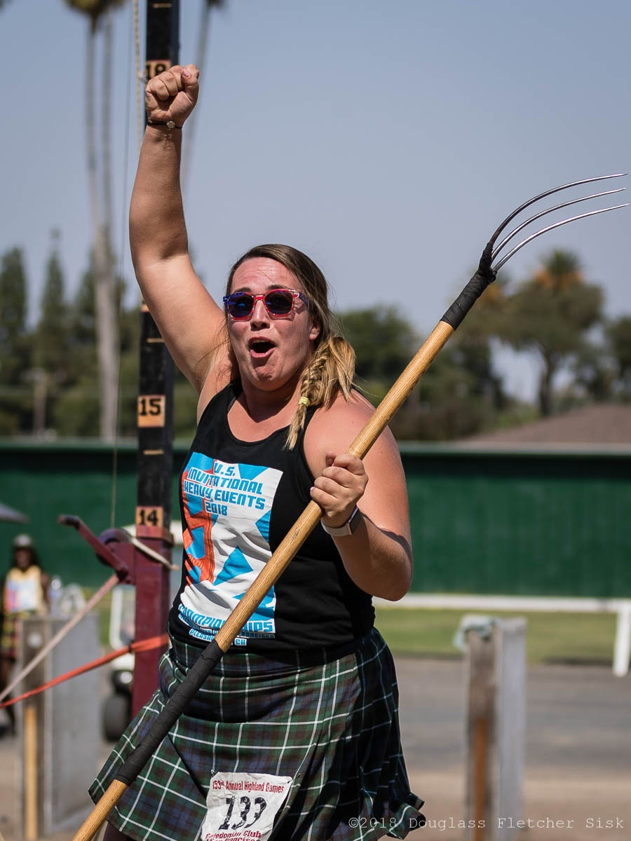 Jessica Bridenthal celebrates after setting a new women's world record on the sheaf. IronMind® | ©Douglass Sisk Photography