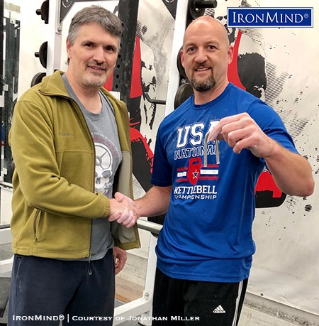 Jonathan Miller (right) has just been certified on the IronMind Red Nail, a benchmark steel bend. Heath Watts (left) refereed Miller's official attempt. IronMind® | Photo courtesy of Jonathan Miller