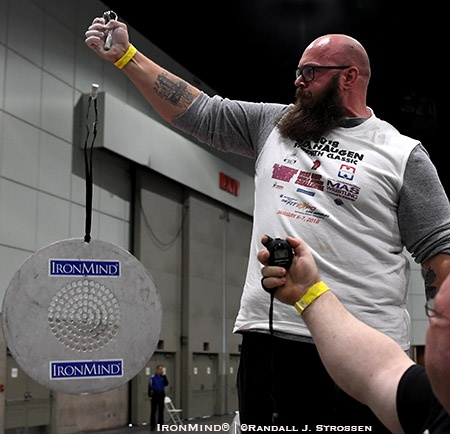 Clay Edgin attacked the CoC Silver Bullet with the Captains of Crush No. 4 gripper at the Armlifting USA grip contest at the 2018 Los Angeles FitExpo. IronMind® | ©Randall J. Strossen