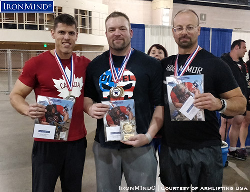 Here are the top three, overall, from the Armlifting USA grip strength competition at the Philadephia FitExpo: (left to right) Eric Roussin (second), Jedd Johnson (first), Riccardo Magni (third). IronMind® | Photo courtesy of Armlifting USA