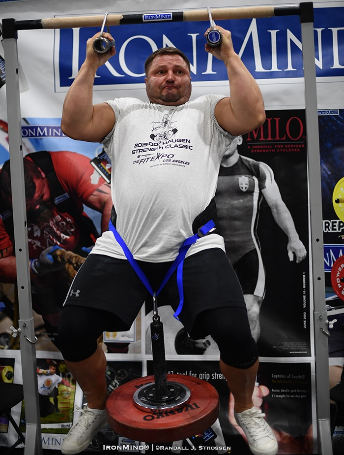 "Alexey ""Tank"" Tyukalov hits a 161.5-kg world record (maximum weight) Rolling Thunder pull-up in the IronMind booth at 2019 Los Angeles FitExpo. IronMind® 