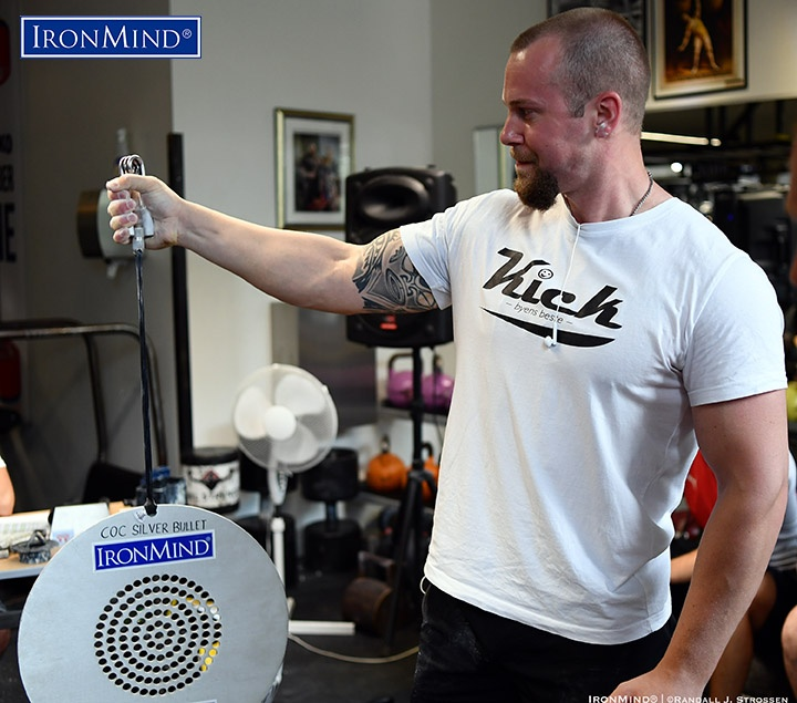 Shown competing on the Captains of Crush (CoC) Silver Bullet Hold, grip strength standout Thomas Larsen (Norway) was the overall winner at the 2019 APL European Armlifting Championships. IronMind® | ©Randall J. Strossen