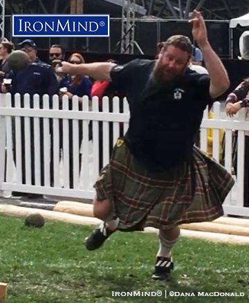 Top-ranked pro Spencer Tyler rang in the debut of the professional class at the Queen Mary Highland Games with two world records, one on the 28-lb. weight for distance (shown), and one on the 20-lb. sheaf toss. IronMind® | ©Dana MacDonald photo