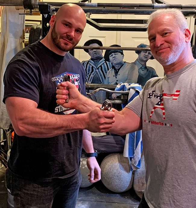 Sal Sabatino (left) has been certified on the Captains of Crush No. 3 gripper, with Steve Weiner, CoC3 '00, Red Nail, '04 refereeing Sal's official attempt to close this legendary gripper. IronMind® | Photo courtesy of Sal Sabatino
