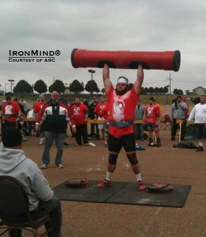 "Adam Scherr on the log press.  ""Adam is another large human and should do fairly well as a pro strongman,"" Dione Wessels said.  IronMind® 