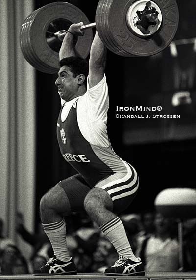 Known for his power jerks, Akakios Kakiasvilis (nee Kakhi Kakhiashvili) had already edged out Anatoli Khrapati on bodyweight for the gold medal in the 99-kg class at the Atlanta Olympics, but nonetheless, he called for 235 kg - not because he needed to lift it, but because he could. IronMind® | Randall J. Strossen photo.