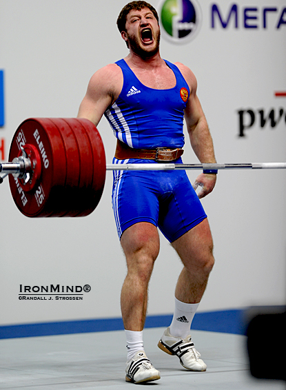 Roaring his approval, Khadzhimurat Akkaev (Russia) finished his six-for-six night with this 230-kg clean and jerk.  IronMind® | Randall J. Strossen photo.