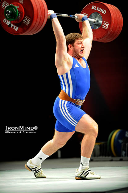 Tell it goodbye: Khadzhimurat Akkaev makes this 232-kg clean and jerk to leapfrog to the gold medal in the jerk and total on the final attempt of the 105-kg category at the World Weightlifting Championships.  IronMind® | Randall J. Strossen photo.