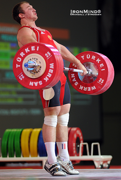 94-kg competitor Alexander Ivanov (Russia) cranks on this 185-kg snatch en route to the gold medals in the snatch and in the total at the 2010 World Weightlifting Championships.  IronMind® | Randall J. Strossen photo.