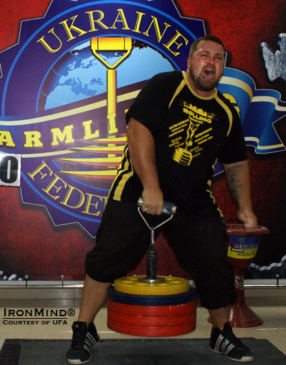 Andrey Sharkov set a new Ukrainian record on the Rolling Thunder, 114 kg, at the Ukrainian Armlifting Championships.  IronMind® | Courtesy of UFA.