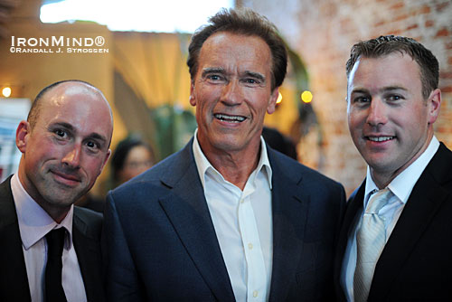California Governor Arnold Schwarzenegger (center) added his considerable clout to the fundraising efforts of Kevin (left) and Paul Doherty (right), two brothers who have more than gone the extra mile in their schools to build an Olympic-style weightlifting program that uses athletic achievement to create multiple opportunities for their students.   IronMind® | Randall J. Strossen photo.