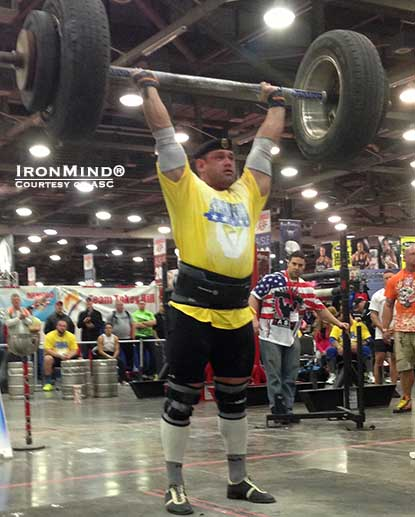 Mikhail Shivlyakov (Russia) on the IronMind Apollon's Axle, on his way to winning the Arnold Amateur Strongman competition.  IronMind® | Photo courtesy of ASC.