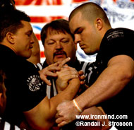 Leonard Harkless (center) makes Marcio Barboza (left) and Travis Bagent (left) street legal in the 2005 Arnold Armwrestling men's superheavyweight final. IronMind® | Randall J. Strossen, Ph.D. photo.