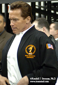On his way to yet another appearance, the world's most famous governor, Arnold Schwarzenegger, emerges into the service corridor behind the main expo stage at the 2005 Arnold Fitness Weekend. IronMind® | Randall J. Strossen, Ph.D. photo.