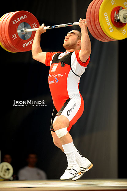 Feet flying, 94-kg Arsen Kasabijew (Poland) splits under this 211-kg jerk at the 2010 European Weightlifting Championships.  The feet are the focus of this month's column by Jim Schmitz, a three-time coach of the USA Olympic weightlifting team.  IronMind® | Randall J. Strossen photo.