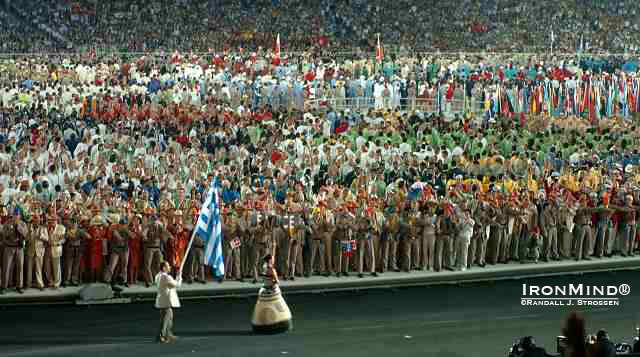 Greek weightlifting superstar Pyrros Dimas leads the parade of nations.  IronMind® | Randall J. Strossen, Ph.D. photo.