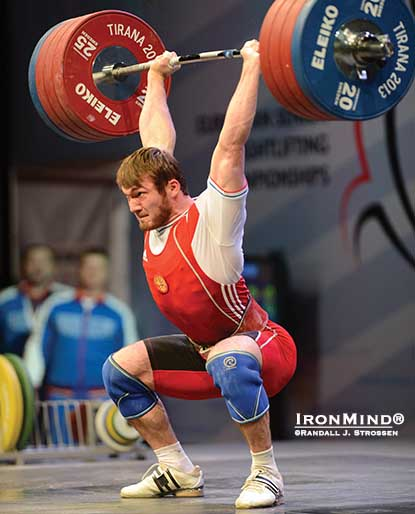 Apti Aukhadov destroyed this 215-kg clean and jerk as he swept the gold medals in the 85-kg category at the 2013 European Weightlifting Championships.  IronMind® | Randall J. Strossen photo.
