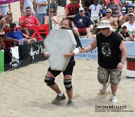 """A tradition of the 'Beach' is the Húsafell carry with a 300-pound cement replica of the Husafell stone.  This is done for distance with the loose sand adding a good measure of difficulty to this challenge!""  IronMind® 