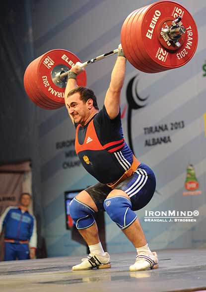 His power jerk is off the charts: David Bedzhanian blasted this 230-kg overhead on his way to defending his senior European 105-kg weightlifting title.  IronMind® | Randall J. Strossen photo