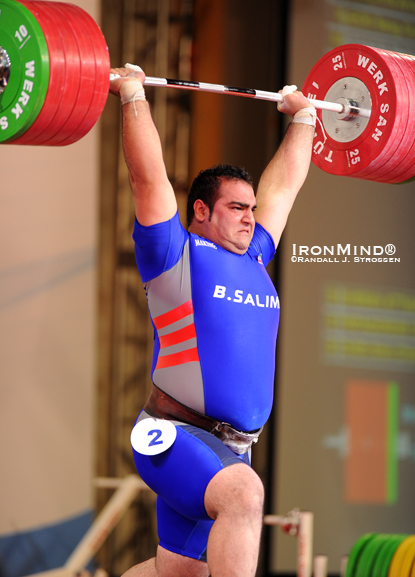 Punching this 245-kg jerk overhead, Behdad Salimi (Iran) won the superheavyweight class at the 2010 World Weightlifting Championships.  IronMind® | Randall J. Strossen photo.